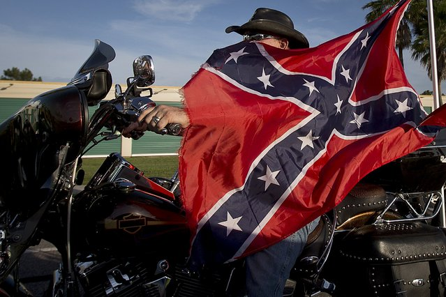 "A biker rides in a ""Ride for Pride"" event to show support for the Confederate flag in Brandon, Hillsborough County, June 26, 2015. (Photo by Carlo Allegri/Reuters)"