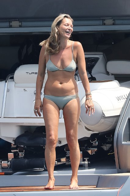 45 year old Kate Moss shows off her bikini body while on vacation in St. Tropez, France on August 6, 2019. The model looks like she's having fun as she poses on the yacht. (Photo by Backgrid USA)