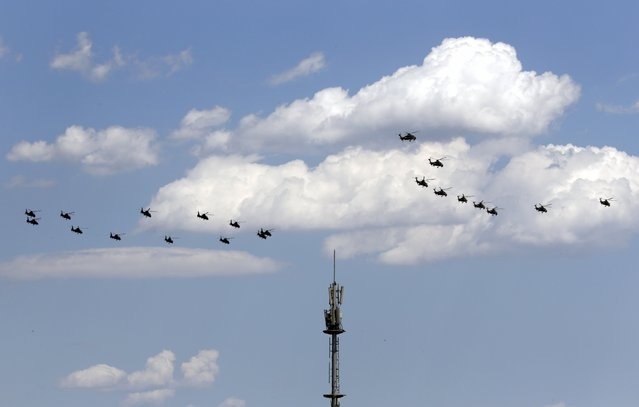 "Military helicopters hover in the formation of the number ""70"" during a training session for the upcoming parade marking the 70th anniversary of the end of World War Two, on the outskirts of Beijing, July 2, 2015. (Photo by Jason Lee/Reuters)"
