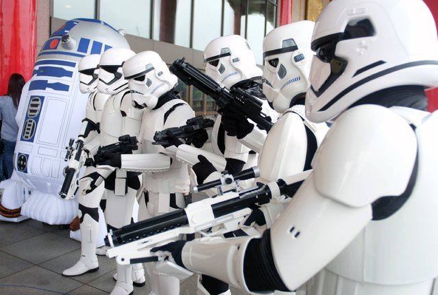 Taiwan Star Wars fans pose for photos during the annual Star War Day in Taipei on May 4, 2016. Some 100 star wars fans dress the different costumes during a cosplay event to mark the annual Star War Day. (Photo by Sam Yeh/AFP Photo)