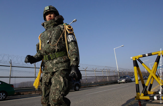 South Korean soldiers walk along barricades at the military check point, near the Demilitarized zone (DMZ) separating South and North Korea