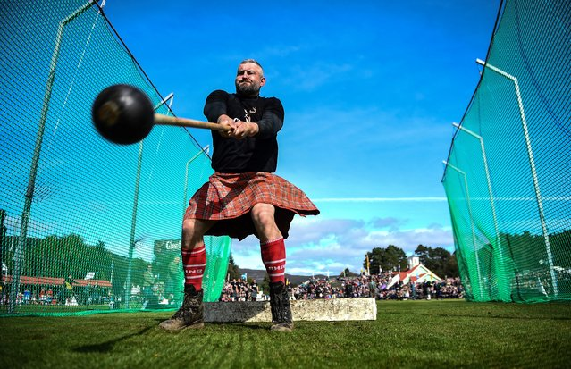A competitor takes part in the throwing the hammer event during the annual Braemar Gathering in Braemar, central Scotland, on September 7, 2019. The Braemar Gathering is a traditional Scottish Highland Games which predates the 1745 Uprising, and since 1848 it has been regularly attended by the reigning Monarch Queen Elizabeth and members of the Royal Family. (Photo by Andy Buchanan/AFP Photo)