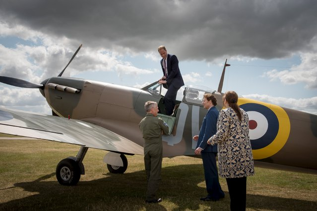 Pilot John Romain (L), Thomas S. Kaplan (2nd R) and Diane Lees, Director General of the Imperial War Museum, speak to Britain's Prince William during his visit to the Imperial War Museum to receive a newly restored Supermarine Spitfire Mark I N3200 on behalf of the museum, in Duxford July 9, 2015. American philanthropist Kaplan donated the Spitfire to the museum. (Photo by Geoff Pugh/Reuters)