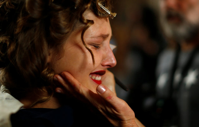 A model cries as make-up is applied backstage before the runway show for label Kitx by Kit Willow during Australian Fashion week in Sydney, May 18, 2016. (Photo by Jason Reed/Reuters)