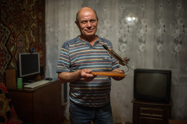 """To be a Ukrainian and to live in a country like Ukraine is a great honor,"" said Nikolay Yaremchuk, 69, on May 22, 2014 – a former Soviet fighter pilot who lives in Kiev but was stationed across territory that now lies deep inside Russia. ""At that time, we didn't consider Russia a different country,"" Yaremchuk said. ""The Soviet Union was our motherland, so Russia was our motherland as well."" Yaremchuk holds a model of a Yakovlev Yak-28 combat airplane, the type he used to fly. (Photo by Alexey Furman/The Washington Post)"