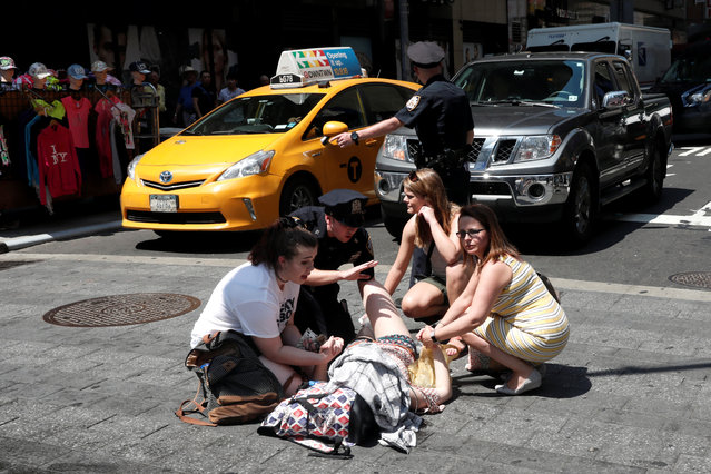 An injured woman is seen at a crosswalk in Times Square after a speeding vehicle struck pedestrians on the sidewalk in New York City, May 18, 2017. (Photo by Mike Segar/Reuters)