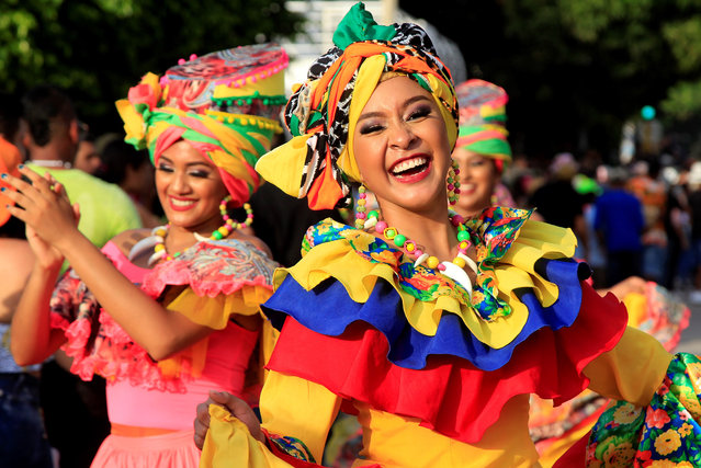 Members of a dance troupe participate in the Cabildo de Getsemani parade as part of the 208th Independence celebrations in Cartagena, Colombia, 10 November 2019. (Photo by Ricardo Maldonado Rozo/EPA/EFE)