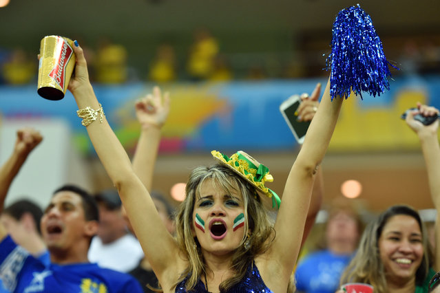Italy fans cheer on their team during the 2014 FIFA World Cup Brazil Group C match between Cote D'Ivoire and Japan at Arena Pernambuco on June 14, 2014 in Recife, Brazil. (Photo by Stuart Franklin - FIFA/FIFA via Getty Images)