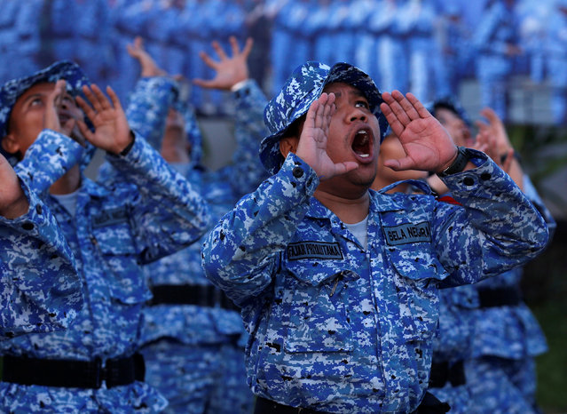 "Participants of the Bela Negara – ""defend the nation"" – programme shout during morning exercise at a training centre in Rumpin, Bogor, West Java, Indonesia June 2, 2016. (Photo by Darren Whiteside/Reuters)"