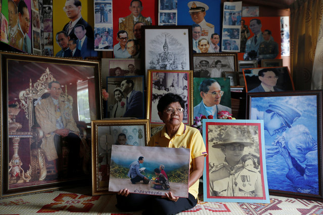 Sanong Bumrungraj, 73, poses with part of her collection of pictures of Thailand's King Bhumibol Adulyadej in Pathum Thani, Thailand, June 8, 2016. Bumrungraj said she has collected more than 100,000 pictures of the royal family over the last 40 years. (Photo by Athit Perawongmetha/Reuters)
