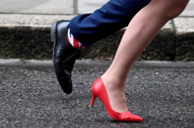 Britain's Health and Social Care Secretary Matt Hancock wears Union Jack socks as he leaves with Britain's Leader of the House of Lords Baroness Evans after a cabinet meeting on Downing Street in London, Britain on January 7, 2020. (Photo by Toby Melville/Reuters)