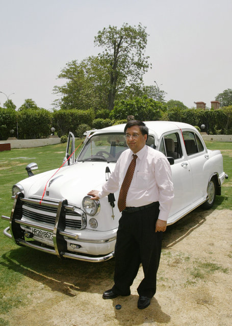 Ashwani Dubey, Executive Vice President of Hindustan Motors, launches a new Ambassador CNG Bharat Stage (BS) III car in New Delhi, India, Wednesday June 15, 2005. The car which comes with a 74 BHP engine and a factory fitted compact natural gas kiT, will come in several models ranging from about $8,800 to about $11,100. (Photo by Saurabh Das/AP Photo)
