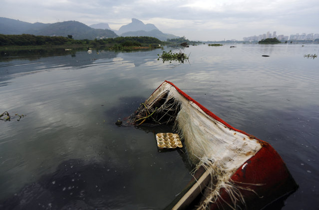 A sofa floats in the polluted waters of Jacarepagua Lagoon, during a press tour in Rio de Janeiro, March 9, 2015. A press tour was organised by biologist Mario Moscatelli, to call attention to pollution on the waters of the lagoons which surround the Rio 2016 Olympic Park. (Photo by Ricardo Moraes/Reuters)