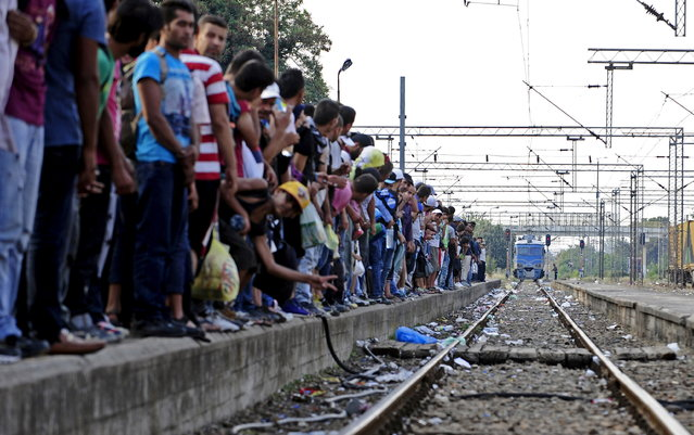 Migrants wait for the train at Gevgelia train station near Macedonia's southern border with Greece July 31, 2015. (Photo by Ognen Teofilovski/Reuters)