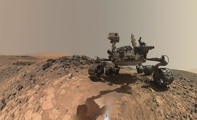 NASA's Curiosity Mars rover is seen at the site from which it reached down to drill into a rock target called 'Buckskin' on lower Mount Sharp in this low-angle self-portrait taken August 5, 2015 and released August 19, 2015. The selfie combines several component images taken by Curiosity's Mars Hand Lens Imager (MAHLI) during the 1,065th Martian day, or sol, of the rover's work on Mars, according to a NASA news release. (Photo by /Reuters/NASA/JPL-Caltech/MSSS)