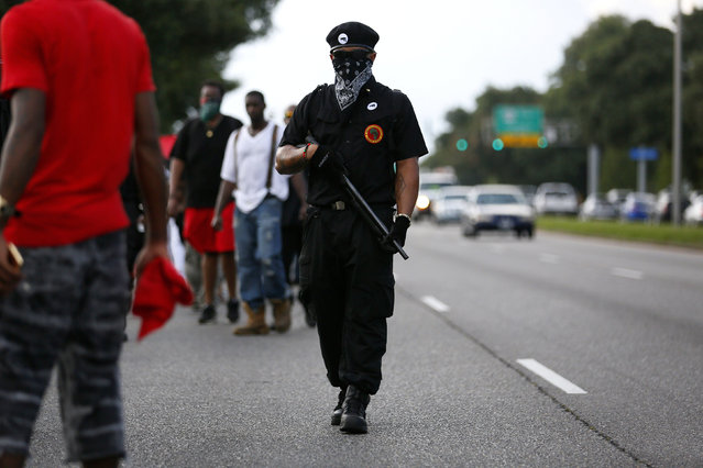 Demonstrators protest the shooting death of Alton Sterling near the headquarters of the Baton Rouge Police Department in Baton Rouge, Louisiana, U.S. July 9, 2016. (Photo by Jonathan Bachman/Reuters)