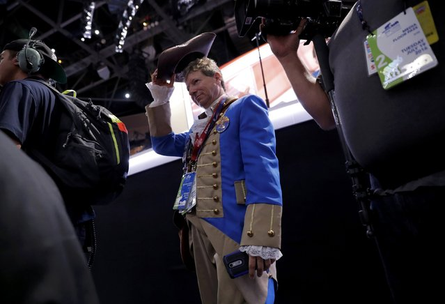 A delegate dressed as a U.S. revolutionary war militiaman walks through the crowd on the floor during the Republican National Convention in Cleveland, Ohio, U.S., July 19, 2016. (Photo by Brian Snyder/Reuters)