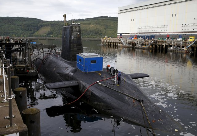 A nuclear submarine is seen at the Royal Navy's submarine base at Faslane, Scotland, August 31, 2015. Britain will spend more than 500 million pounds ($769.5 million) refurbishing its nuclear submarine base in Scotland over the next 10 years, finance minister George Osborne said on Monday. (Photo by Russell Cheyne/Reuters)