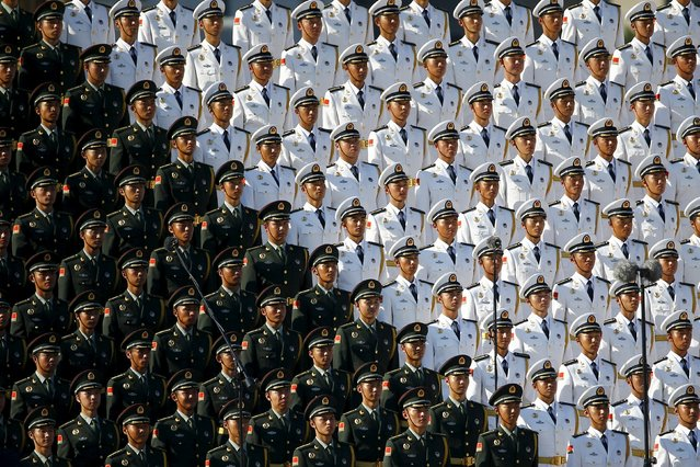 Members of military choir stand in formation at the Tiananmen Square before a military parade to mark the 70th anniversary of the end of World War Two, in Beijing, China September 3, 2015. (Photo by Damir Sagolj/Reuters)