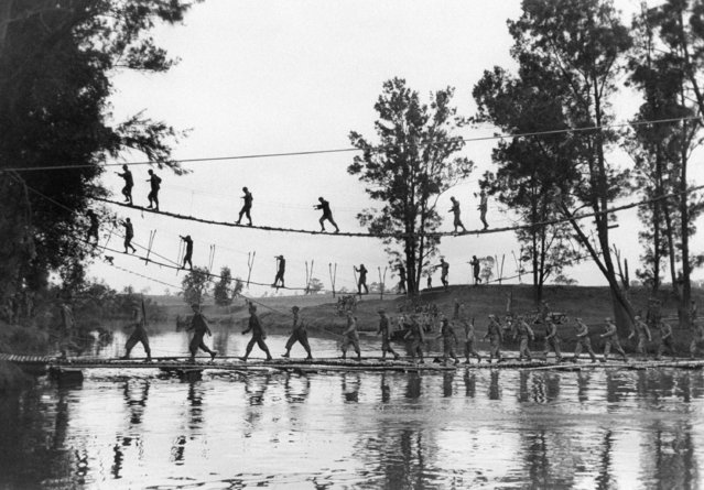 Men practicing river crossing on various types of improvised bridges somewhere in the South Pacific on September 8, 1943. (Photo by Myron H. Davis/AP Photo/Life)