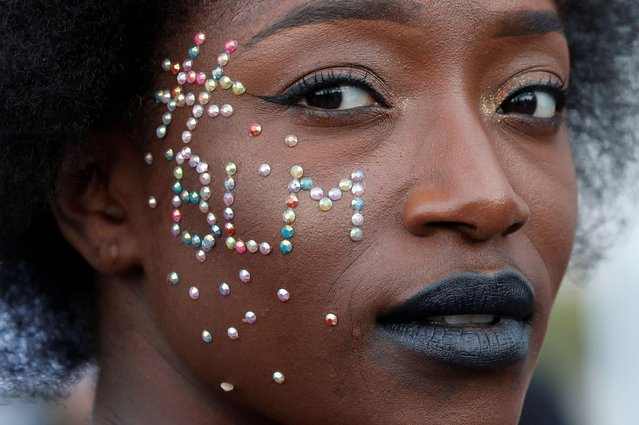 A woman attends a banned demonstration planned in memory of Adama Traore, a 24-year old black Frenchman who died in a 2016 police operation which some have likened to the death of George Floyd, in front of a courthouse in Paris, France on June 2, 2020. (Photo by Gonzalo Fuentes/Reuters)