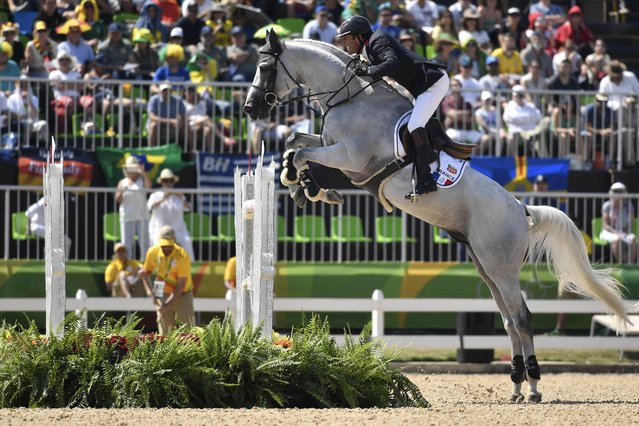 France's Philippe Rozier riding Rahotep de Toscane takes part in the jumping competition at the Olympic Equestrian Centre during the Rio 2016 Olympic Games in Rio de Janeiro on August 17, 2016. (Photo by Philippe Lopez/AFP Photo)