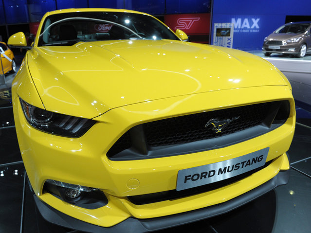 A Ford Mustang 2015 is displayed  at the 2014 Paris Auto Show on October 2, 2014 in Paris, on the first of two press days. (Photo by Eric Piermont/AFP Photo)
