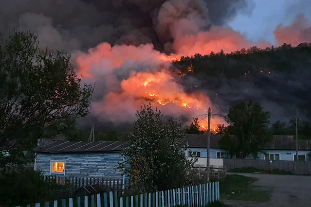 A wildfire in a forest near the village of Anavgai in Bystrinsky District, Kamchatka Territory, Russia on June 17, 2020. (Photo by Russian Emergencies Ministry/TASS)