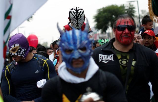 Mexican wrestlers take part in their annual pilgrimage to the Basilica of Our Lady Guadalupe in Mexico City, Mexico August 25, 2016. (Photo by Carlos Jasso/Reuters)