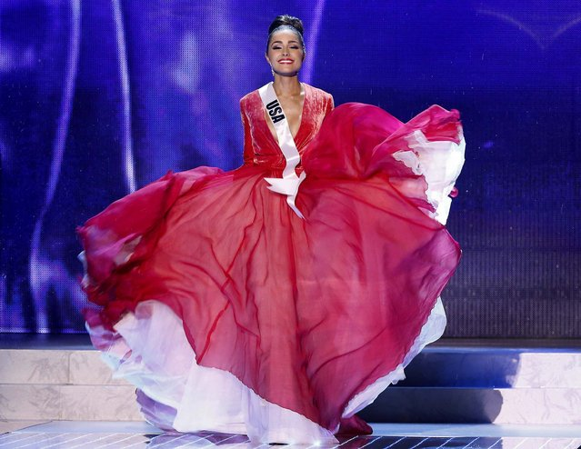 Miss USA, Olivia Culpo, walks on stage during a performance by Australian singer Timomatic. (Julie Jacobson/Associated Press)