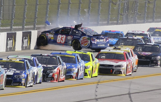 J.J. Yeley (83) wrecks on the backstretch during the NASCAR Sprint Cup Series auto race at Talladega Superspeedway, Sunday, October 19, 2014, in Talladega, Ala. (Photo by Greg McWilliams/AP Photo)