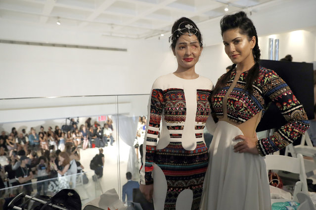 Model and acid attack victim Reshma Querishi, left, and actress Sunny Leone pose for photos backstage after modeling in the Archana Kochhar collection during Fashion Week in New York, Thursday, September 8, 2016. (Photo by Mary Altaffer/AP Photo)