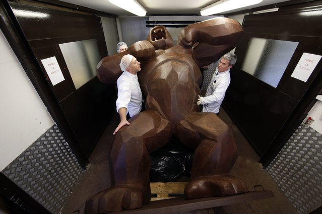 Assistants of French chocolate maker Jean-Paul Hevin work on a four-metre (13-feet) tall chocolate King-Kong created by Richard Orlinski in Colombes, near Paris, on the eve of the 20th Salon du Chocolat (Paris Chocolate Show), October 27, 2014. (Photo by Benoit Tessier/Reuters)
