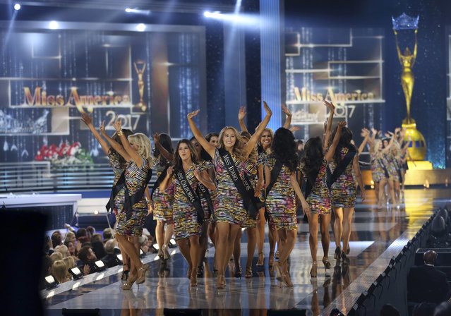 Contestants wave during the Miss America 2017 pageant, Sunday, September 11, 2016, in Atlantic City, N.J. (Photo by Mel Evans/AP Photo)