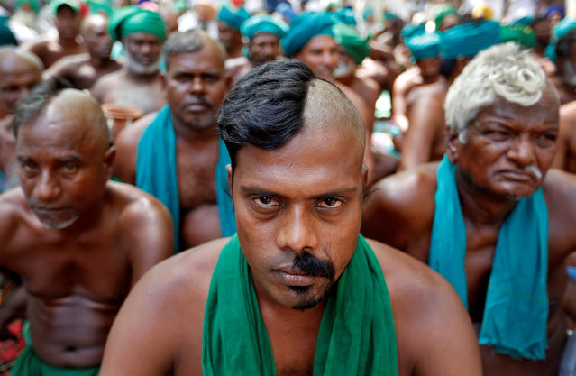 Farmers from the southern state of Tamil Nadu pose half shaved during a protest demanding a drought-relief package from the federal government, in New Delhi, India April 3, 2017. (Photo by Cathal McNaughton/Reuters)