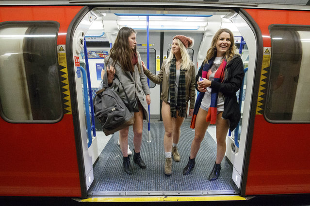 Passengers wear no trousers as they ride the London Underground in London, Britain, 07 January 2018. The No Pants Subway Ride is an global annual event where people take the public transport while they are not wearing trousers to surprise other passengers. This event takes place on the first Sunday of every year in the world's major cities. (Photo by Tolga Akmen/EPA/EFE/Rex Features/Shutterstock)