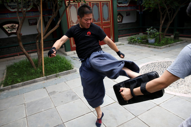 "Kung Fu master Xing Xi practices as he trains in mixed martial arts at his Kung Fu academy ""Kung Fu Zen"" in Beijing, China, July 3, 2016. (Photo by Kim Kyung-Hoon/Reuters)"