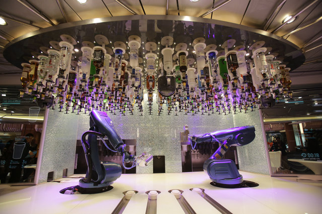 The so-called robot bartenders wait for a customer onboard the cruise ship Quantum of the Seas which is currently docked at Southampton on October 31, 2014 in Southampton, England. (Photo by Matt Cardy/Getty Images)
