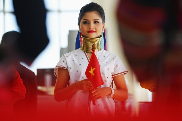 A girl wears traditional costume of one of Myanmar's ethnic groups during the welcoming ceremony ahead of the opening ceremony of the 25th Association of Southeast Asian Nations (ASEAN) summit in Naypyitaw November 12, 2014. World leaders will descend on the capital of Myanmar this week, an event unthinkable over almost half a century of military rule, amid concern reforms that opened the country to international engagement have gone into reverse. (Photo by Damir Sagolj/Reuters)