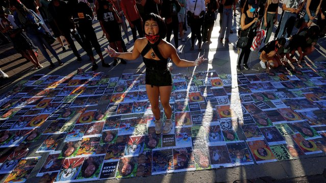 """Ameya Okamoto dances over images of victims of police violence at a """"Rally for Black Lives, Black Voices and Jacob Blake"""" in Boston, Massachusetts, U.S., September 5, 2020. (Photo by Brian Snyder/Reuters)"""