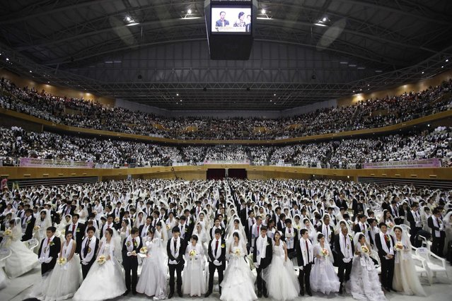Thousands of newlyweds attend a mass wedding ceremony of the Unification Church at Cheongshim Peace World Centre in Gapyeong, about 60 km (37 miles) northeast of Seoul February 17, 2013. The Unification Church founded by evangelist reverend Moon Sun-myung in Seoul in 1954, performed its first mass wedding in 1961 with 33 couples. Approximately 3,500 couples attended the mass wedding on Sunday. (Photo by Kim Hong-Ji/Reuters)