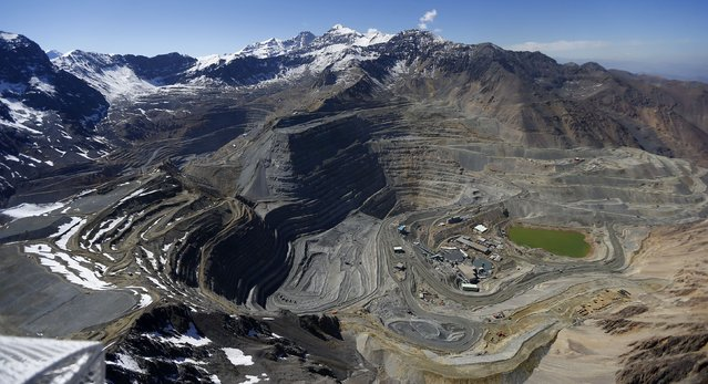 An aerial view of open pits of CODELCO's Andina (L) and Anglo American's Los Bronces (front) copper mines with Olivares glaciers in the background (top) at Los Andes Mountain range, near Santiago city, November 17, 2014. (Photo by Ivan Alvarado/Reuters)