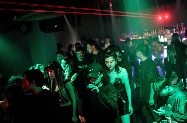 People dance inside the disco bar on September 18, 2020 in Wuhan, Hubei province, China. As there have been no recorded cases of community transmission in Wuhan since May, life for residents is returning to normal. (Photo by Getty Images)