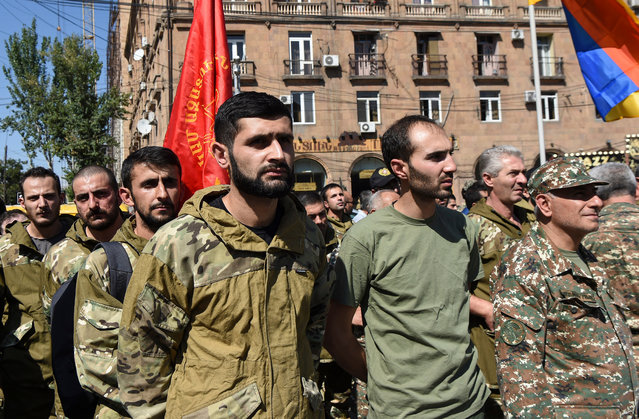 Volunteers of Armenian Revolutionary Federation gather to leave for Artsakh (Nagorny-Karabah region), where martial law has been declared near Aram Manukyan's statue in Yerevan, Armenia, 27 September 2020. According to media reports, Armenia has imposed martial law and total military mobilisation after clashes have erupted in the territorial conflict between Armenia and Azerbaijan in Nagorno-Karabakh Republic, with both sides reporting civilian deaths after shelling, artillery and air attacks along the front. (Photo by Melik Baghdasaryan/EPA/EFE)