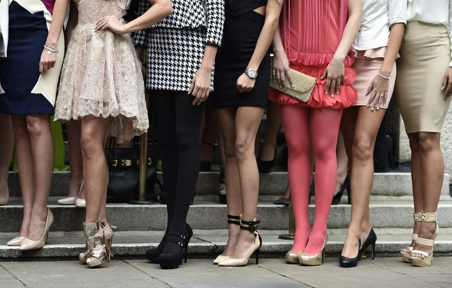 Miss World 2014 finalists pose during a publicity launch in central London November 25, 2014. (Photo by Toby Melville/Reuters)