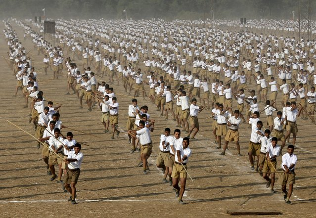 Volunteers of the Hindu nationalist organisation Rashtriya Swayamsevak Sangh (RSS) take part in a drill on the last day of their three-day workers' meeting in Ahmedabad, India, in this January 4, 2015 file photo. The ascendant Hindu nationalist group wants minority Muslims and Christians to accept that India is a nation of Hindus, and is pushing some of them to convert. (Photo by Amit Dave/Reuters)