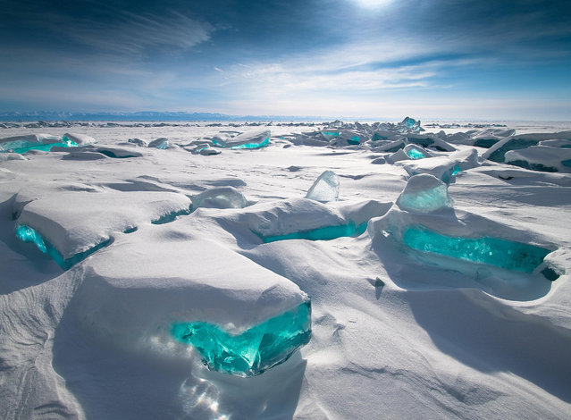 """""""Baikal Treasure"""". This shot of snow hummocks with the ice backlit by the midday sun at Lake Baikal in Siberia was voted the public's favourite. (Photo by Alexey Trofimov/Royal Meteorological Society's Weather Photographer of the Year Awards)"""