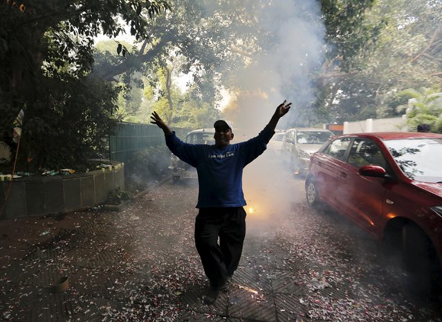 A supporter of Janata Dal (United) dances as he celebrates after learning the initial results inside the residence of the party leader Sharad Yadav in New Delhi, India, November 8, 2015. (Photo by Anindito Mukherjee/Reuters)