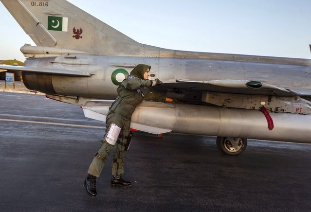 Ayesha Farooq, 26, Pakistan's only female war-ready fighter pilot, performs a pre-flight check on a Chinese-made F-7PG fighter jet at Mushaf base in Sargodha, north Pakistan June 6, 2013. (Photo by Zohra Bensemra/Reuters)
