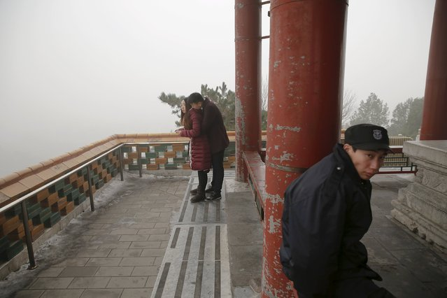 People visit the Jingshan Park on an extremely polluted day as hazardous, choking smog continues to blanket Beijing, China December 1, 2015. (Photo by Damir Sagolj/Reuters)